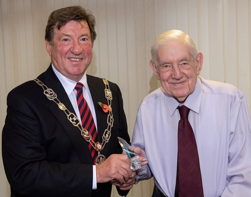 Chairman of Richmondshire District Council, Councillor Bill Glover, presents Jack with his Bevan medal.