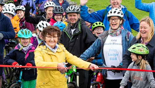Yvonne Peacock cuts the ribbon to open the Swaledale Trail image