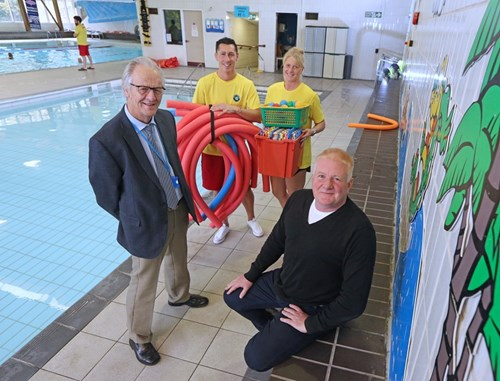 Councillor Ian Threlfall with pool staff Phil Heron, Lisa Birkett and manager Austin Gordon